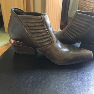 Unique, distressed brown leather boots.